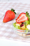 Strawberry and fruit salad in white plate Royalty Free Stock Photos