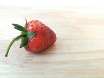 Red strawberry on wooden floor stock photo