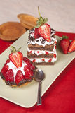Strawberry fruit tart and chocolate strawberry cake on a plate Royalty Free Stock Photography