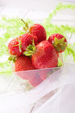 Strawberry fruits in a cup Stock Photos