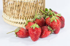 Strawberry fruits details in basket isolated white background Stock Photos