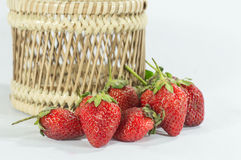 Strawberry fruits details in basket isolated white background Royalty Free Stock Photos