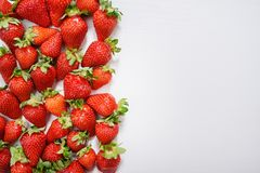 strawberry fruits on the left side on wooden background with copy space. View from above Stock Images