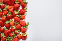 strawberry fruits on the left side on wooden background with copy space. View from above Stock Photos
