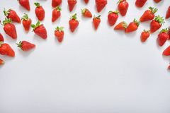 strawberry fruits on the above side on wooden background with copy space. View from above. Royalty Free Stock Photos