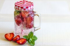 Strawberry Fruits Sliced in Half Near Clear Glass Container Royalty Free Stock Photography