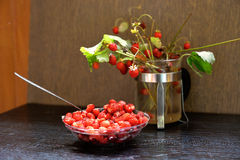 Strawberry fun. Still life with wild strawberries on the table Royalty Free Stock Photos