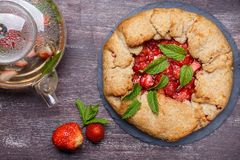 Strawberry galette. Homemade healthy wholegrain berry open pie. Fruit tart. Top view stock photos