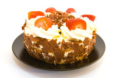 Strawberry Gateau. Whole strawberry gateau on a black plate with a white background Stock Image