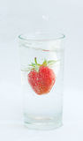 Strawberry in a glass Stock Images