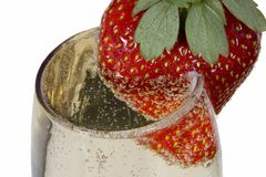 Strawberry on a glass. With bubbly drink - champaign stock image