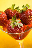 Strawberry and glass Royalty Free Stock Image