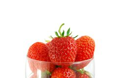 Strawberry in the glass. Closeup on the white background stock images