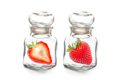 Strawberry in the  glass bottle Stock Photos