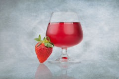 Strawberry and glass of cranberry juice Royalty Free Stock Photo