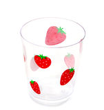 Strawberry glass isolated. A clear plastic cup with strawberries isolated over white Stock Photo