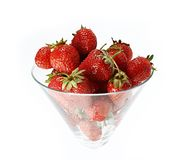Strawberry in the glass isolated on a white. Strawberry in the glass on a white background Royalty Free Stock Photo