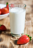 Strawberry and glass of milk Royalty Free Stock Photography