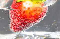 Strawberry in glass of mineral water. Royalty Free Stock Image