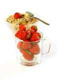Strawberry in glass and muesli isolated on white Royalty Free Stock Photography