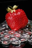 Strawberry on Glass Pebbles Royalty Free Stock Image
