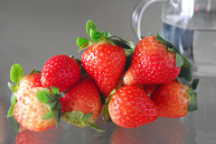 Strawberry with Glass of water. Strawberry with a cup of Glass water Royalty Free Stock Photography