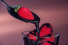 The strawberry watered with chocolate Stock Photo