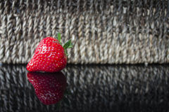 Strawberry on glossy table. Royalty Free Stock Photos