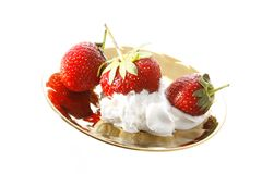 Strawberry in a golden plate Stock Photos
