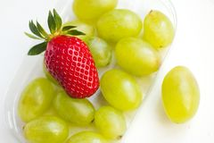 Strawberry and grapes Stock Image