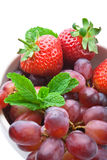 Strawberry, grapes and mint stock photos