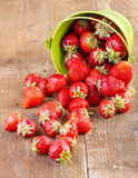 Strawberry in a green metal bucket on wood Stock Photos