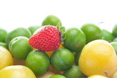 Strawberry, green and yellow plum Royalty Free Stock Photo