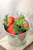 Strawberry. A group strawberry in pail on table royalty free stock image
