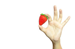 Strawberry in hand Stock Image
