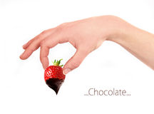 Strawberry in hand with chocolate Royalty Free Stock Images