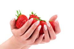Strawberry in the hands on white background Royalty Free Stock Photography