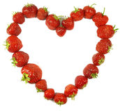 Strawberry heart. Red strawberies forming a heart on white Royalty Free Stock Images