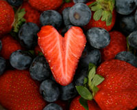 Strawberry Heart on berries Royalty Free Stock Photo