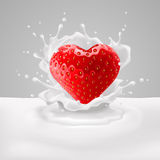 Strawberry heart with milk. Appetizing strawberry heart in milk splashes. Love for food Stock Image