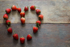 Strawberry. In heart shape on the wood table Royalty Free Stock Photography