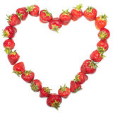 Strawberry heart. Heart of strawberries creating frame Royalty Free Stock Image