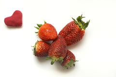 Strawberry and hearth Stock Photography