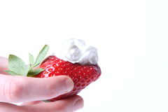 Strawberry in her hand isolated Stock Photo