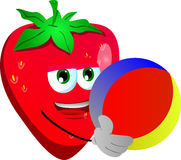 Strawberry holding a beach ball Royalty Free Stock Photo