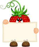 Strawberry holding a blank sign Royalty Free Stock Photos