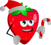 Strawberry holding a candy cane and wearing Santa's hat Stock Image