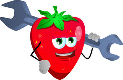 Strawberry holding a huge wrench Royalty Free Stock Images