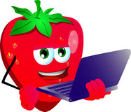Strawberry holding laptop Stock Image