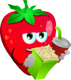 Strawberry holding popcorn and soft drink Royalty Free Stock Image
